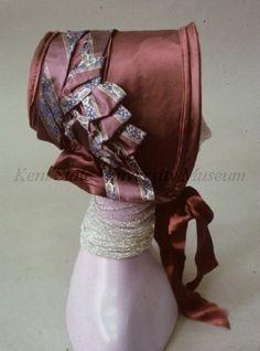 American Bonnet. 1845-49  Purple satin poke bonnet with satin ribbon trim.