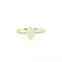 Idée et inspiration bague:   Image   Description   Opal Ring / 14k Gold Pear Shape Opal Engagement Ring with White Diamonds set in Micro Pave / White Opal Ring/ October Brithstone