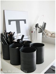 Recycled/Upcycled cans, with matte black paint, as organizers. Could paint or add paper to match ANY decor, from this masculine tailored look to cutesy bright little girls room.  And can use any size cans: from wee to giant.  #upcycled #tin #can #recycled #craft #crafting
