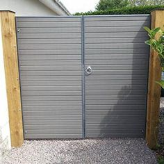 Eco Woodgrain Double Gates A matching pair of gates for the Eco fencing system. Manufactured using gravelboards with a steel bracing. Comes complete with hinges and rose catch fitted. Can be made in all colours. We recommend that Eco gates are hung off a timber post concreted in at the side of the Eco posts. Perfectly Fence Gates, Fencing, Timber Posts, Double Gate, Outside Storage, Houzz, Wood Grain, All The Colors, Tall Cabinet Storage