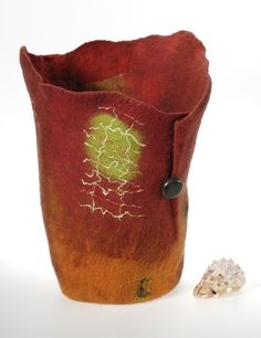 """Felted and sculpted vessels made from Australian wool and silk fibres """"In seeking ways to develop my response and expressing it through textiles, I began exploring felting and sculpting techniques...."""