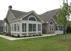 Architecture, Front View American Home Design Green Grass Beige Natural Stone Cladding White Wall Gray Wooden Wall Concrete Pathway Glass Window White Wooden Fence: The Most Famous Legendary American modern house decorating ideas pictures