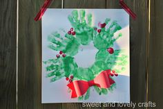 handprint wreath with 3D bow. Would love to do one of these each year as a keepsake.