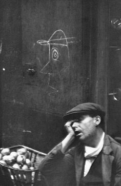 Henri Cartier-Bresson. The hand on the face with the arm as a leading line, seems to be a favorite technique. RG.