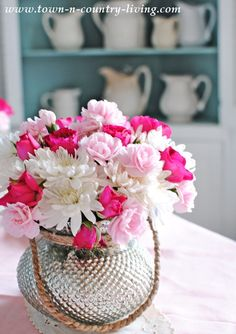 Roses, mum, and carnations - dining room centerpiece