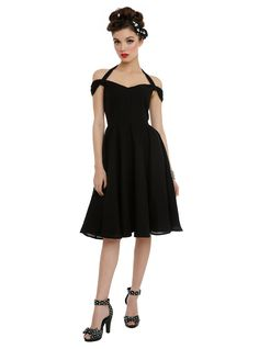 <p>Black swing dress from Hell Bunny with a swiss dot pattern, halter and…