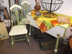 $175 - Vintage table with drop leaves and 2 chairs. Painted cream & green - great for small spaces.  ***** In Booth H8 at Main Street Antique Mall 7260 E Main St (east of Power RD on MAIN STREET) Mesa Az 85207 **** Open 7 days a week 10:00AM-5:30PM **** Call for more information 480 924 1122 **** We Accept cash, debit, VISA, Mastercard, Discover or American Express