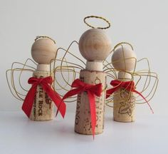 What fun these have been. Little woodenheads on used wine cork bodies, with wire twisted halos and wire wound wings.  You will receive one Angel, But there are more available.