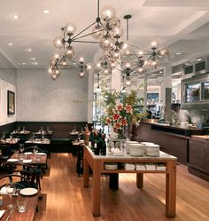 Modo Chandelier - 4 Sided, 15 Globes (Black/Smoke) — Locanda, San Francisco. Designed by Jason Miller for Roll & Hill