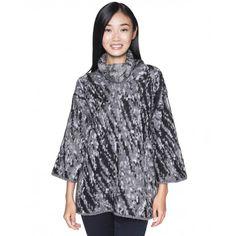 Camisola jacquard quente com gola alta ampla e manga comprida. Vestibilidade oversize.