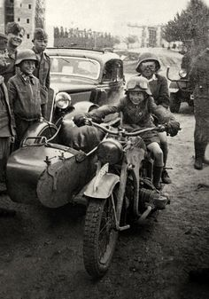 Hitlerjugend posing on a Zundapp KS 750