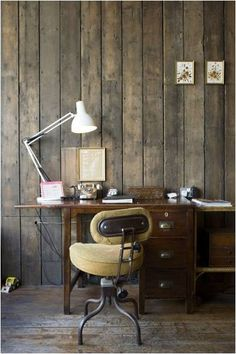 love the lamp, chair and wooden wall and table - thats everything i think!