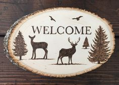 Wood-burned welcome sign that I made. #deer #pinetrees
