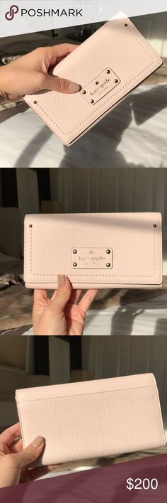 Kate Spade Baxter Street Wallet NWT. Light pink envelope wallet with gold hardware. Multiple card slots and pockets. kate spade Bags Wallets