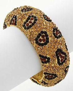"HOT HOT HOT!!! Leopard HUGE BLING Crystal & Rhinestone Topaz Animal Print Metal Hinged Bangle by Jersey Bling Jersey Bling Animal Jewelry. $49.99. hinged bangle. 2 1/2"" wide. handmade. metal plated. Save 40% Off!"