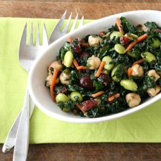 Kale Edamame salad: MIX Kale, fresh mint and basil, edamame, chickpeas, sliced carrots, craisins, lemon juice, salt, pepper, garlic, and dried italian herb blend.