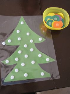 Velcro-dot Christmas tree and colored discs.  Teaching color names to toddlers.