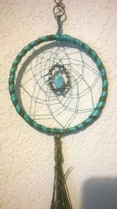 Romantic Rendezvous is a Dream Catcher with a Treasure, Your treasure, Kingman mine Turquoise Cabochon Center, Flanked by Peacock feathers by DreamCatcherMan on Etsy