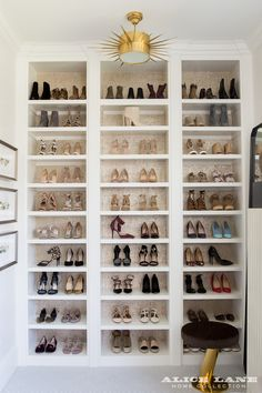 rows and rows of shoes and a fabulous semi flush mount light fixutre