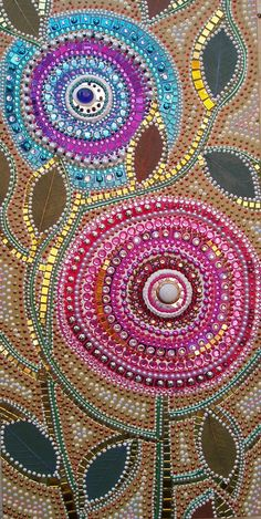 30cm x 60cm deep edge canvas with a build up of acrylic paint and dots, mirrors and acrylic gems.