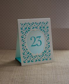 Woven Table Number Tents / Luminaries / Wedding Table Numbers / Table Markers / Table Tents - Woven Style B. $3.00, via Etsy.
