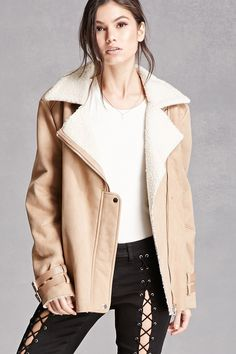 A faux suede moto jacket featuring a faux shearling lining, an asymmetrical zipper and snap-buttoned front, notched collar, long sleeves with adjustable faux leather straps, zippered front pockets, and adjustable button tabs at the waist. This is an independent brand and not a Forever 21 branded item.