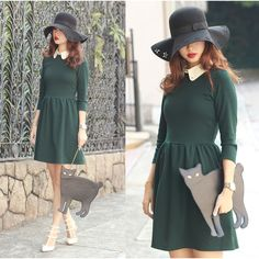 Love the hat, forest green color and the collar. Not sure about the pleats since it would target my least favorite body part... I also love the sleeves!