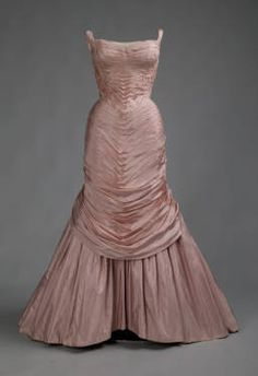 """1957, Charles James; James created his first TREE gown in 1955; this version followed two years later. He stated that the design used """"faille stretched like a ruched membrane over a stiffened shell molded NOT to the figure of the client, but to the shape I wished it were."""" He created numerous versions of this dress in various colors between 1955 and 1958."""