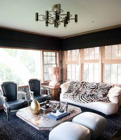 Dark and dramatic. Grey living room with marble coffee table and white sofa. LOVE the old Hollywood style