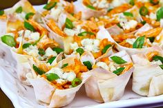 "Buffalo Chicken Cups Recipe    Ingredients:        2-3 boneless, skinless chicken breasts      2 Tbsp. olive oil      1/2 tsp. smoked paprika      1/2 tsp. chili powder      24 wonton wrappers      1 Tbsp. butter, melted      1/2 cup cayenne hot sauce (I recommend Frank's ""Red Hot"")      1/2 cup blue cheese crumbles      3 scallions, sliced thinly"