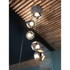 Five cut-out chrome shades elegantly cascade down from the base of this large meteor shower ceiling lamp. The perfectly choreographed spiral of the pendants mesmerizes your senses and offers a fresh look for your decor.