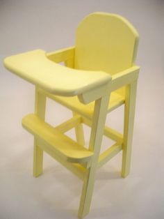 WOOD KIDS DOLL HIGH CHAIR  THE HIGH CHAIR ON DISPLAYED COLOR YELLOW  THIS HIGH CHAIR COMES IN A VARIETY OF COLORS.  THE TRAY ON THIS HIGH CHAIR DOES NOT LIFT UP.  IT WAS BUILT LIKE THIS SO CHILDREN WOULD NOT GET THERE FINGERS HURT,  MADE AND BUILT IN THE USA  GOING BACK TO THE OLD STYLE TOYS   THIS UNIT IS SHIPPED FULLY ASSEMBLED  CONDITION NEWLY MADE IN THE U. S.   Measurement 11 1/2 in. by 11 1/2 in. by 25 in. high   All glue and paint are child safe and non-toxic. Great old fashioned toy…