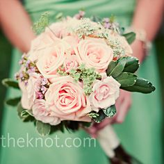 The bridesmaids carried garden-inspired hand-tied bouquets of pink garden roses, light-peach spray roses, pink wax flowers and Queen Anne's lace.