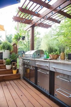 This outdoor kitchen and string light covered pergola are seamless extensions off an existing deck. A Place of my Taste created a resort-worthy patio space perfect for entertaining. Outdoor Kitchen Plans, Outdoor Kitchen Design, Diy Kitchen, Kitchen Decor, Outdoor Kitchens, Kitchen Ideas, Kitchen Planning, Kitchen Design Open, Patio Kitchen