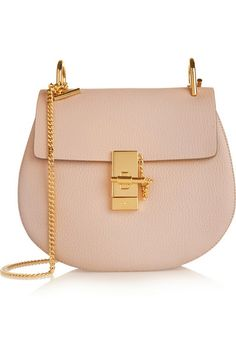 Chloé's 'Drew' shoulder bag comes in a new smaller size this season - perfect for off-duty days. It's crafted from blush textured-leather elegantly enhanced by polished gold hardware. The plush beige suede interior is ideally proportioned to hold your cell phone, keys and makeup essentials. Shop it now at NET-A-PORTER.COM #Chloe