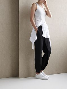 white tank top, shirt tied around the waist, black slouchy pants & sneakers #style #fashion