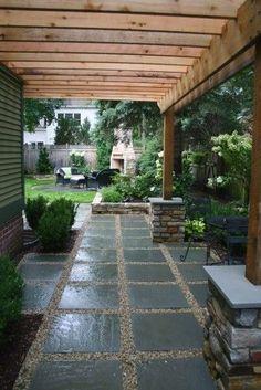 Beautiful backyard with pergola and fireplace beyond.