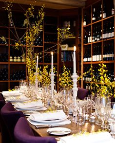 Beautiful wine cellar dining - yellow orchids, purple accents - The Lake House, Daylesford, Australia