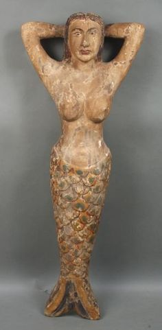 """Folk Art carved and painted wooden mermaid, 47""""h. x 17 1/2""""w.."""