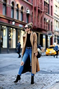 Helena Glazer kills it in this cute winter style, consisting of distressed denim jeans, an oversized camel coat, and spike heeled booties for that perfect edgy feel! Coat: Mackage, Bodysuit: Only Hearts, Denim: Levis, Belt: Saint Laurent, Booties: Louboutin.