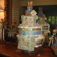 Click on the above link for the step-by-step instructions for creating this adorable Beatrix Potter Peter Rabbit Diaper Cake!