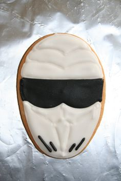 The Stig! - The Stig, from the BBCs Top Gear programme.  Made as party favours for my son's 9th birthday treat.  Butter cookies with Royal Icing floodwork.