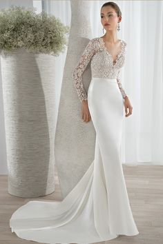 Style 625 This sleek luxe satin Sheath gown features a lace bodice with a plunging V-neckline and long lace sleeves. Transitioning to a high back with button closures and a sophisticated Chapel length train.