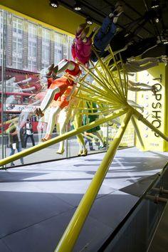 NEON architects: riba colour mannequin wheel installation