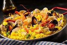 Paella La Margarita Shellfish Including Pink Stock Photo (Edit Now) 388506634 Seafood Recipes, Cooking Recipes, Saffron Rice, Seafood Restaurant, Spanish Food, Mussels, Rice Dishes, Food Design, Margarita