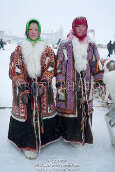 Image of two young khanty women wearing traditional reindeer skin coats with fox fur collar & decorated with inlaid fur. the one on the right has extensive bead work decoration on the front and shoulders. salekhard, yamal, western siberia, russia by ArcticPhoto