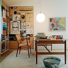 Here's another nice-looking home office with a huge  desk. I really like the corkboard inspiration wall. Recognize Finn Juhl's work? from A...