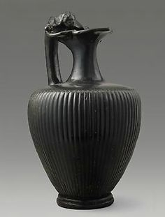 Black Glaze Oinochoe with Silenos Head Handle  PERIOD  ca. 300 BC  CULTURE  Etruscan  CATEGORY  Greek