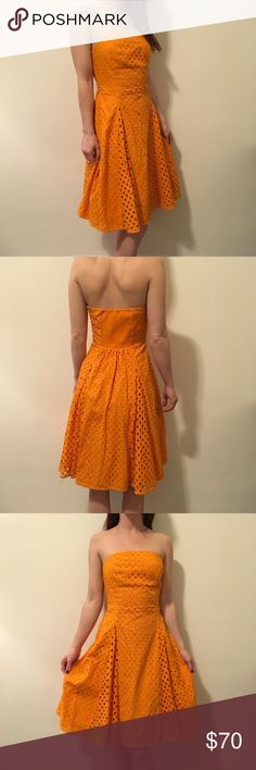 Maeve Anthropologie Orange Eyelet Strapless Dress Maeve by Anthro Eyelet dress that is Strapless and is lined- zipper closure and is super retro like and in great condition! Only worn a few times- size 2 and is a soft cotton fabric! Anthropologie Dresses Strapless