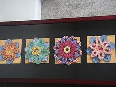 Display idea for quilling flowers.